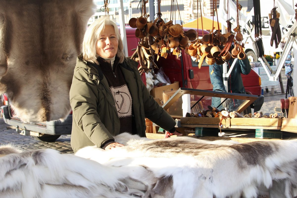 Snow white reindeer rug as souvenirs at Market Square Helsinki