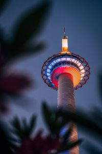 An ombre of lights on Kyoto Tower at night in Kyoto, Japan