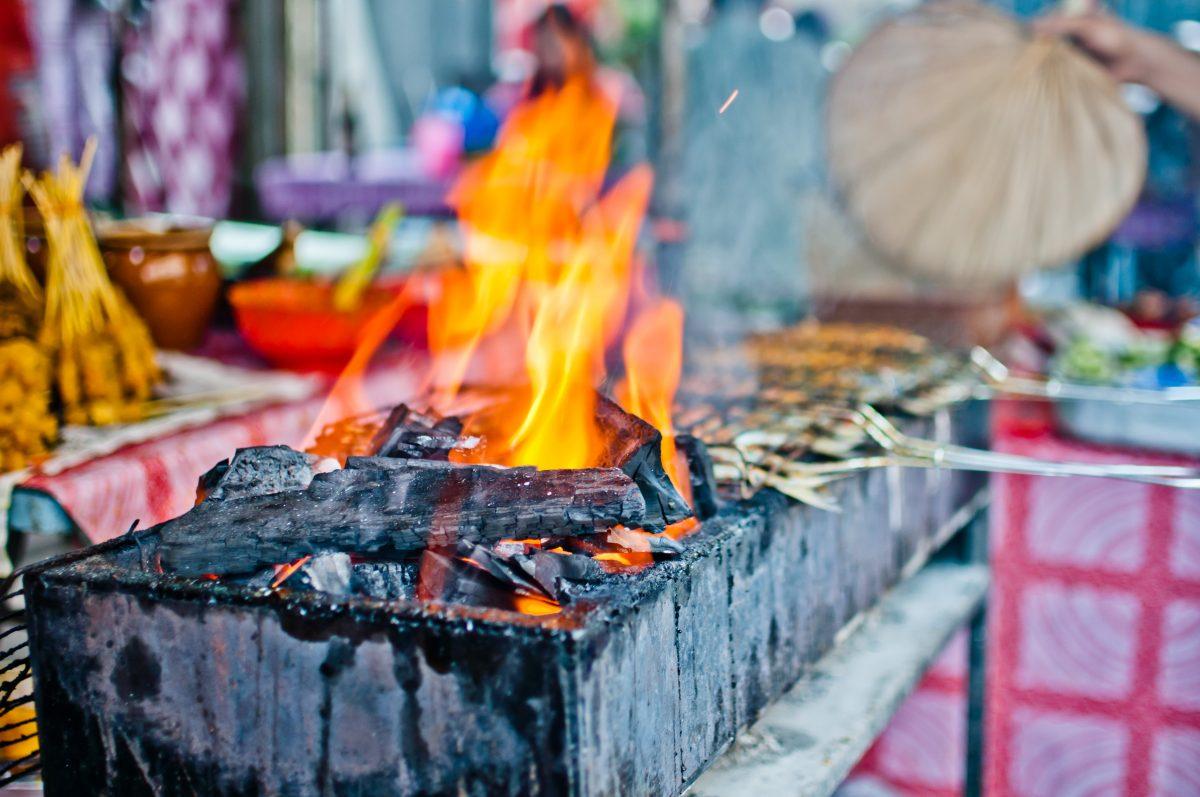 Roaring fire during the street-side cooking in Kuala Lumpur, Malaysia