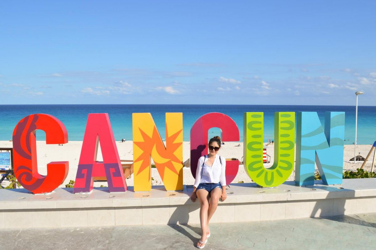 Traveler posing at Cancun's most photographed spot
