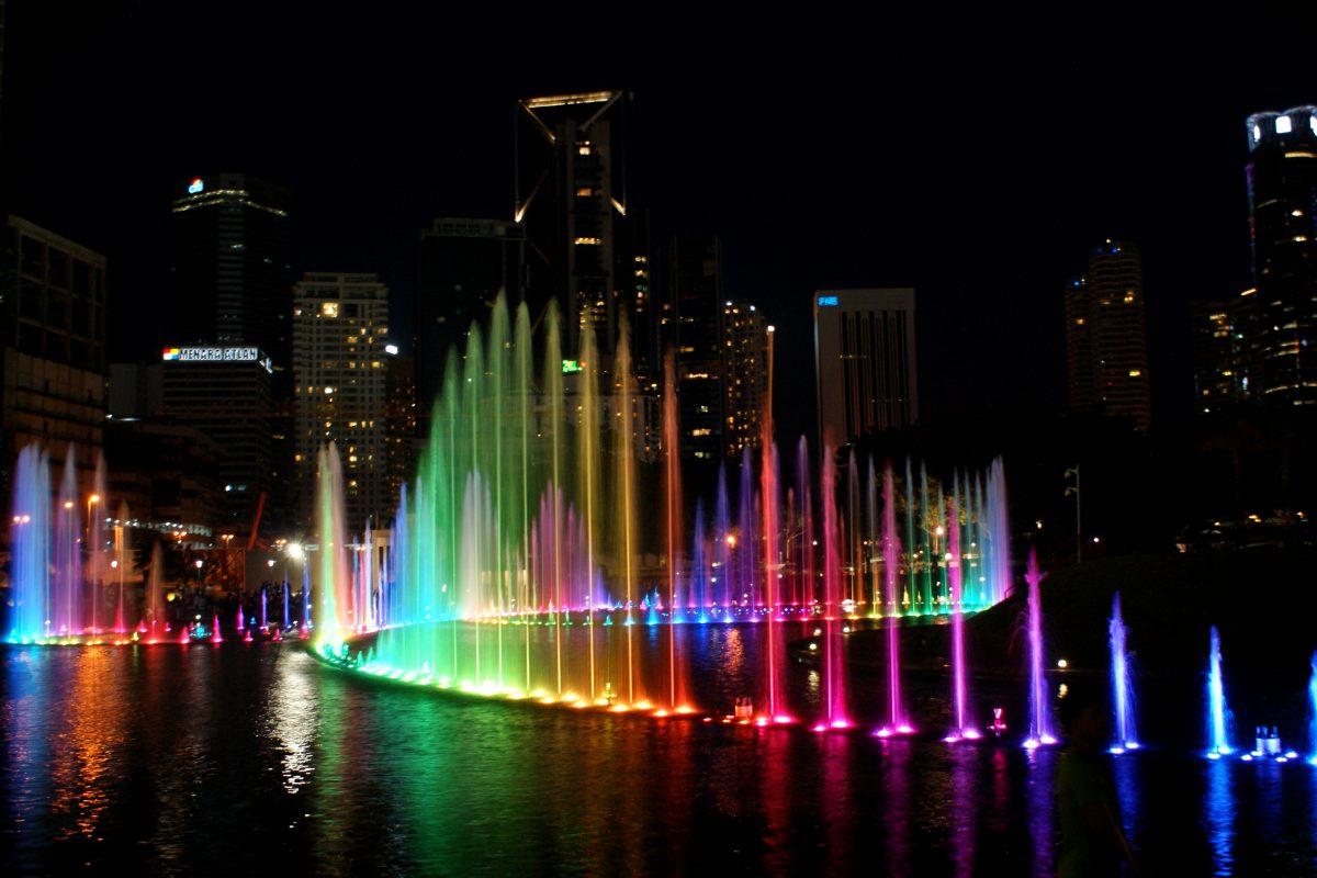 Colourful KLCC Park Lake Symphony fountain at night