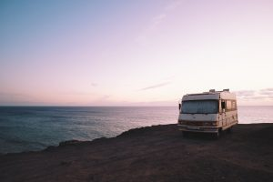 A Motorized RV parked near the edge of a cliff