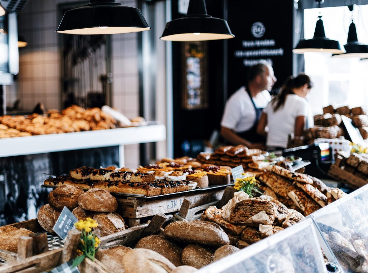 Pastries on display at an indoor food market