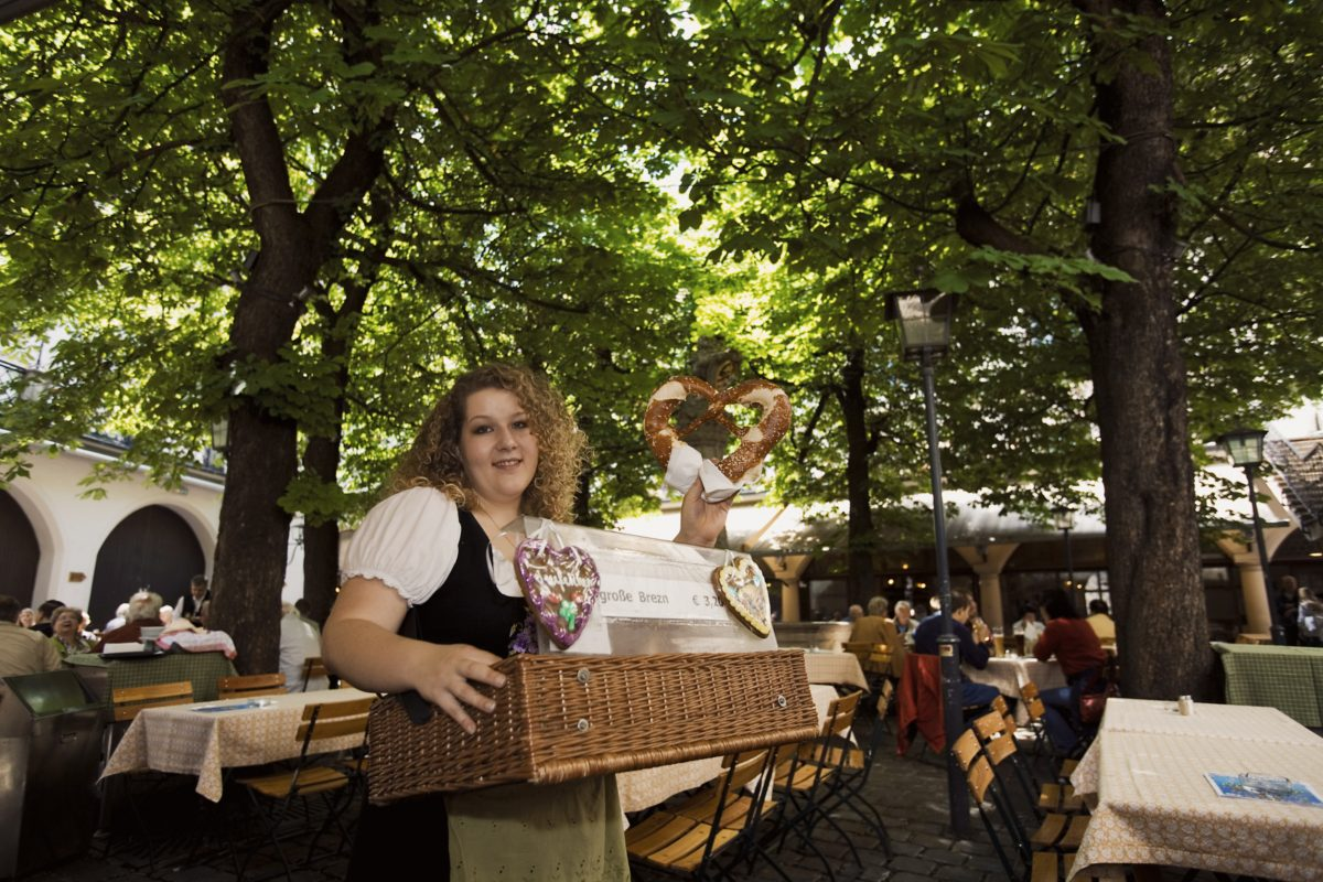 Pretzel (or Pretzle) seller in a beergarden (or Beergarten) Munich, Germany
