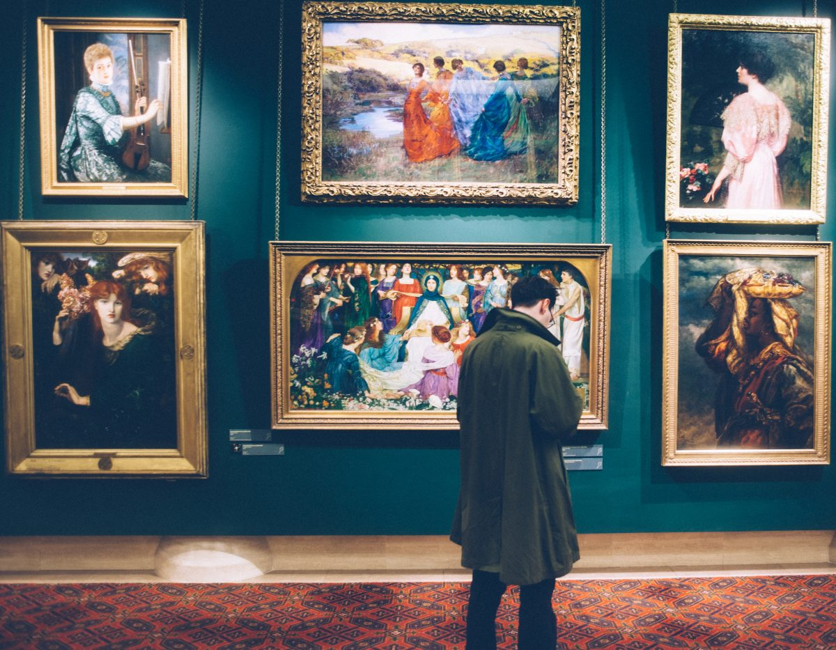 A man admiring the artworks on display at an art gallery