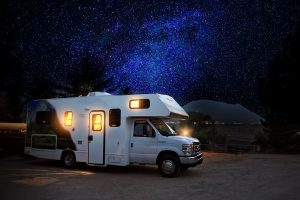 An RV parked under the stars