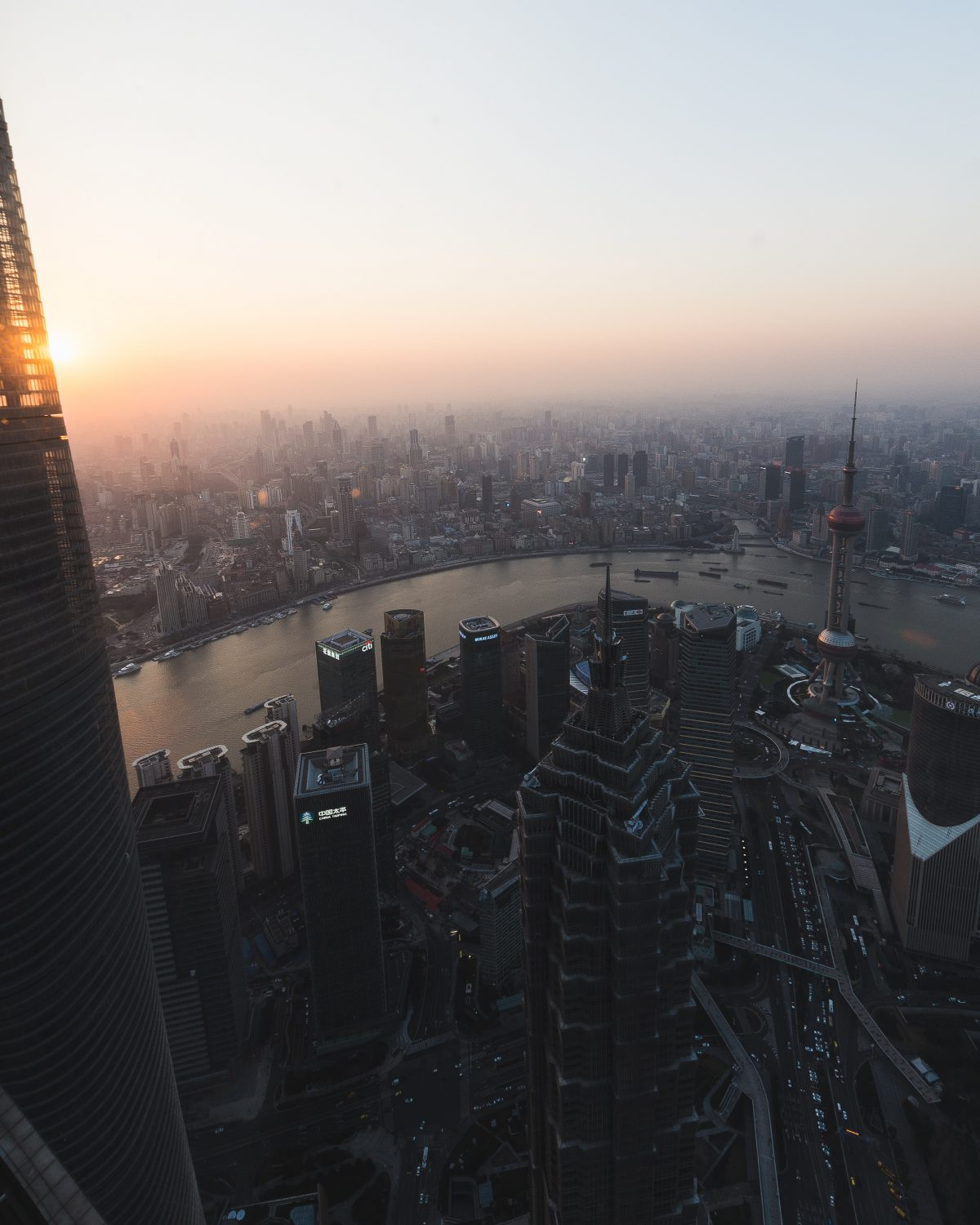 Panoramic view of Shanghai city from the Shanghai World Financial Centre in the evening sun