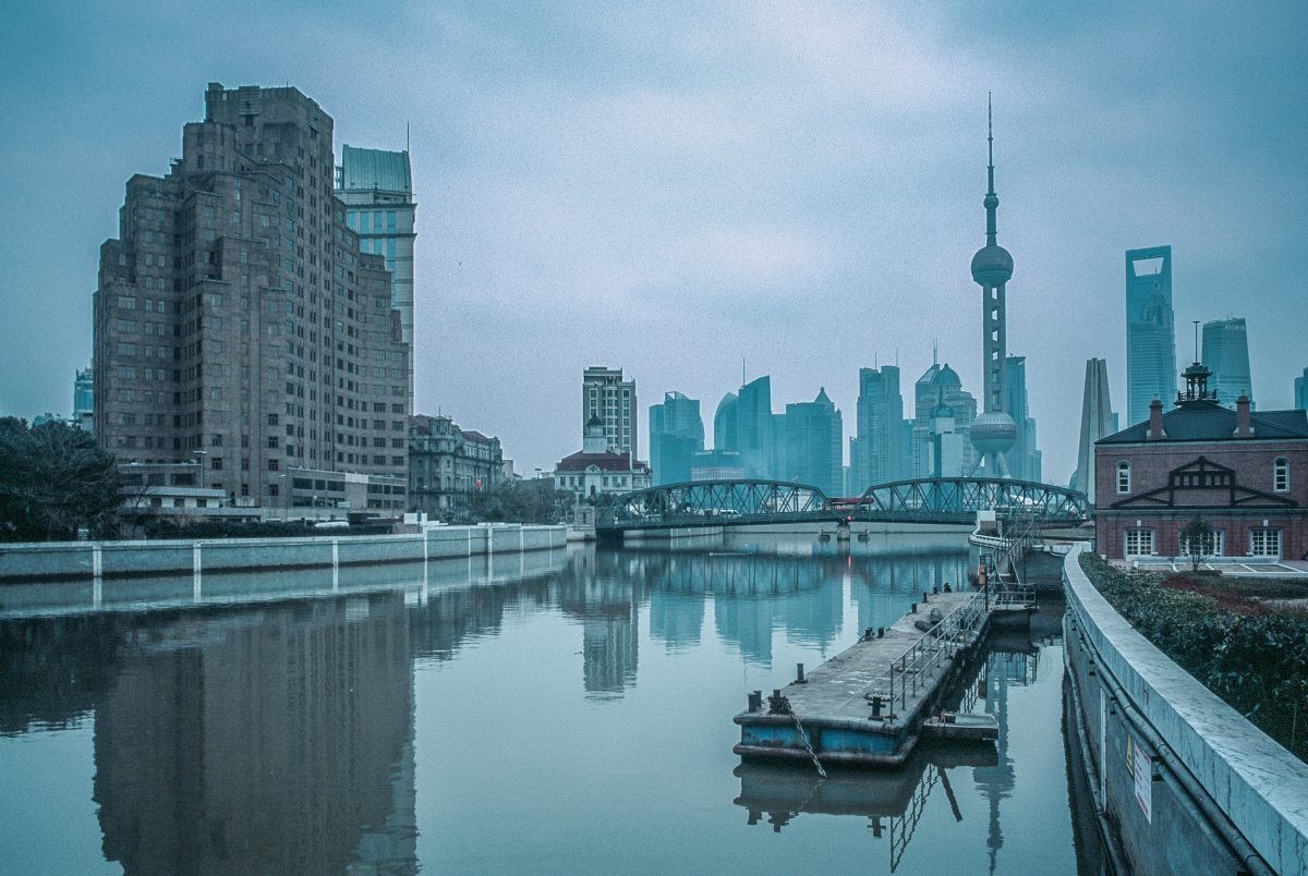 Waterfront view of The Bund during a foggy day with many iconic landmarks in sight