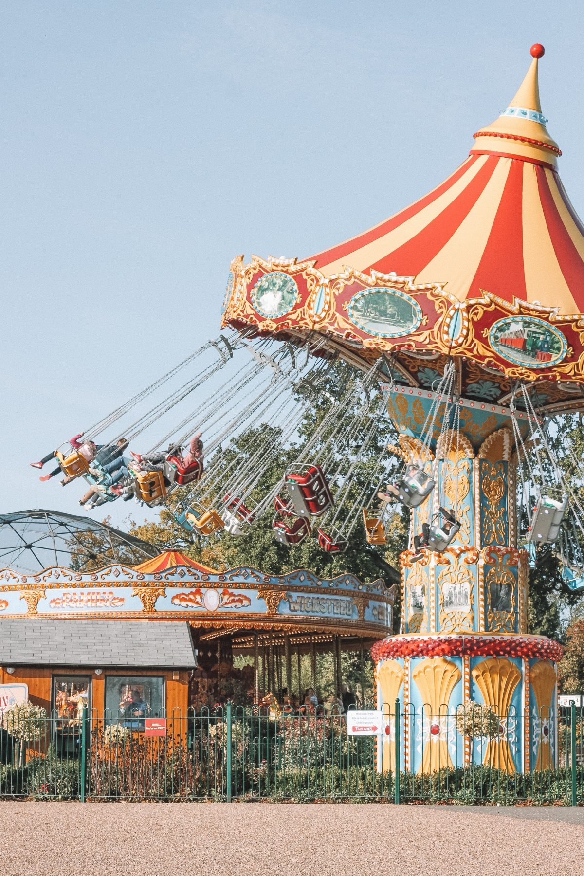 An amusement park ride in the afternoon sun