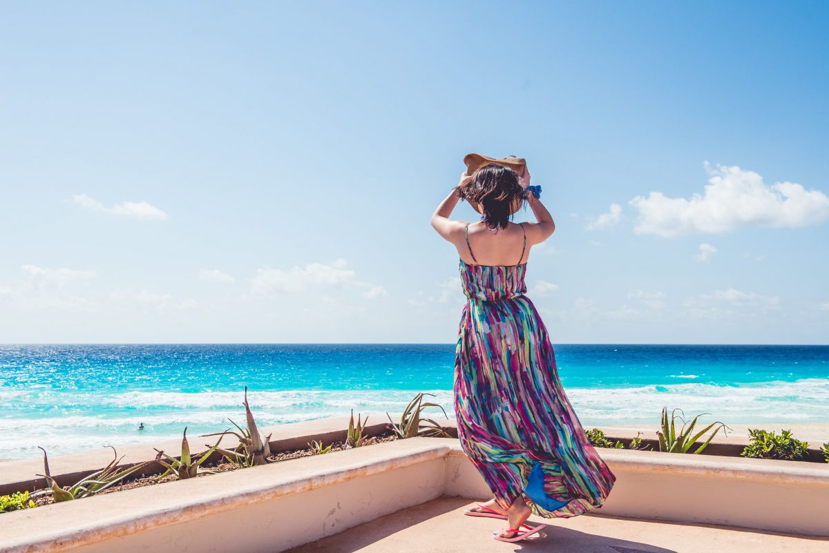 A lady stepping out to explore The Hotel Zone of Cancun