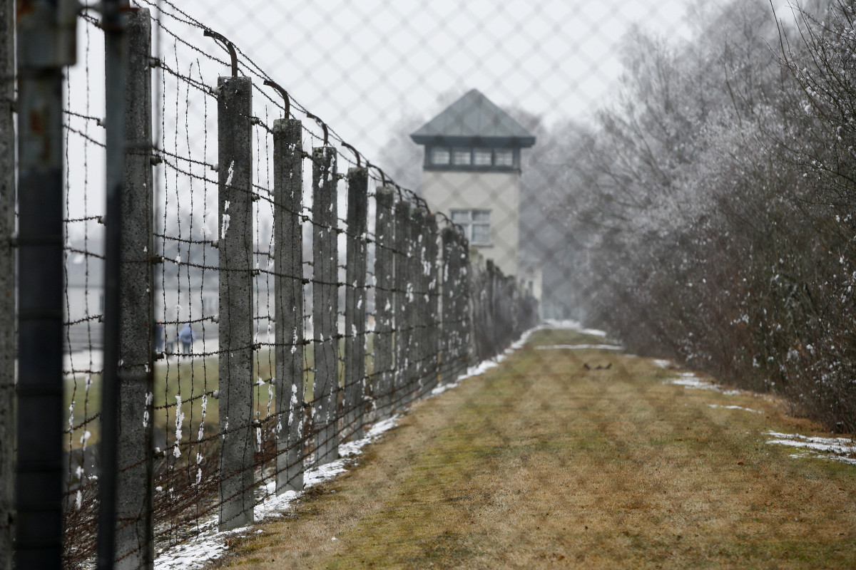 Reflect about past at nazi dachau concentration camp