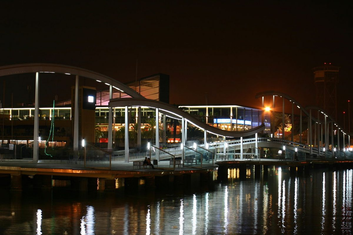 Beautiful night view of the wooden bridge leading to Maremagnum