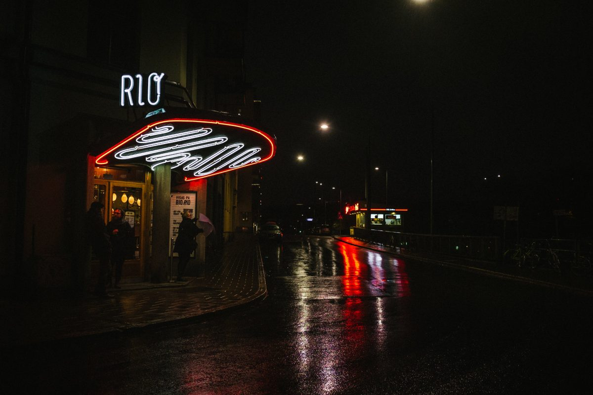 Bio Rio, gorgeous night time shot of wet streets, traffic and the Bio Rio Cinema night lights