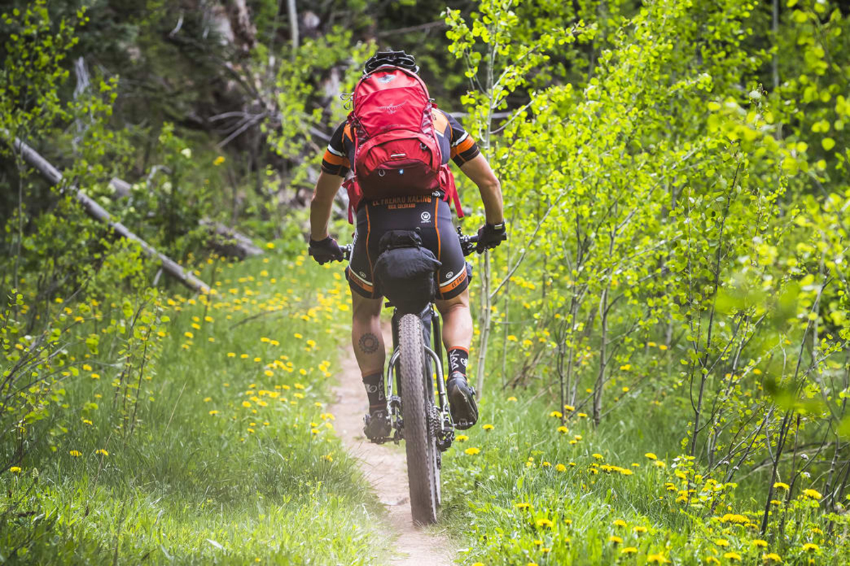 Adventure biking with a backpack