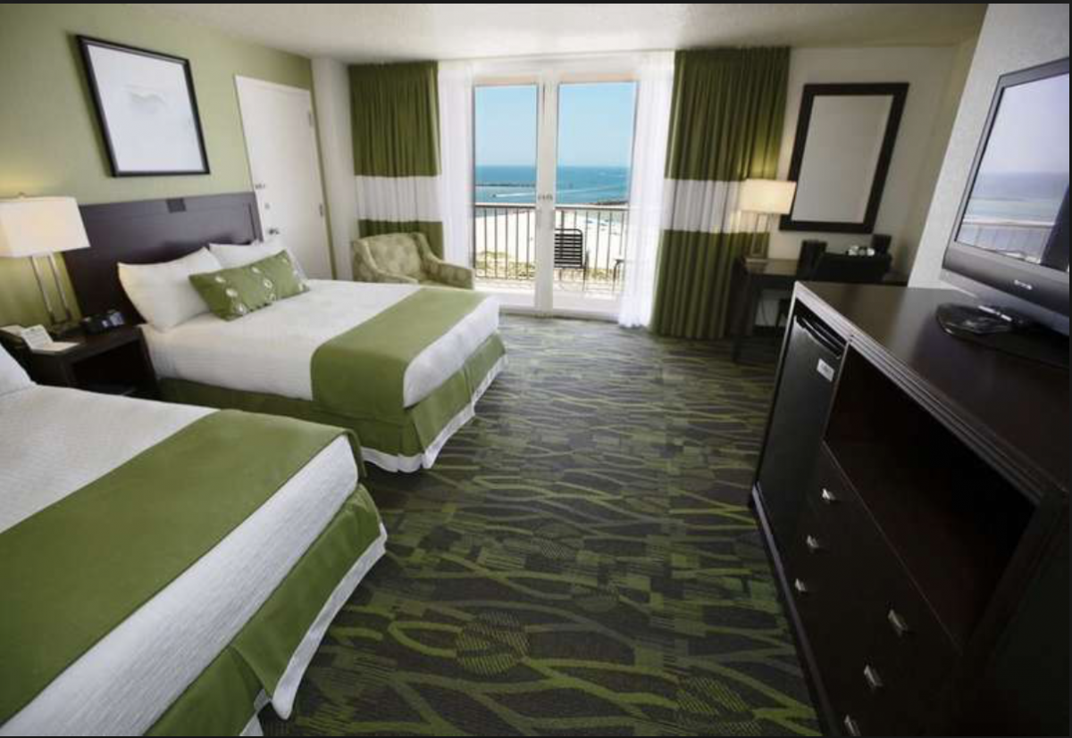 Dressed and decorated in soothing tones of green and white, the rooms at the Perdido Beach Resort seems to resemble spas rather than hotel rooms