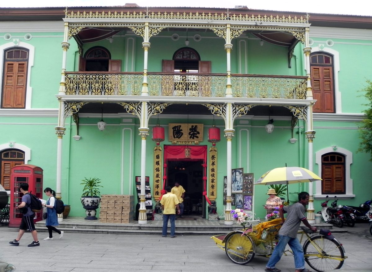 Ground view of Pinang Peranakan Mansion in Penang with its awesome green walls and oriental decor