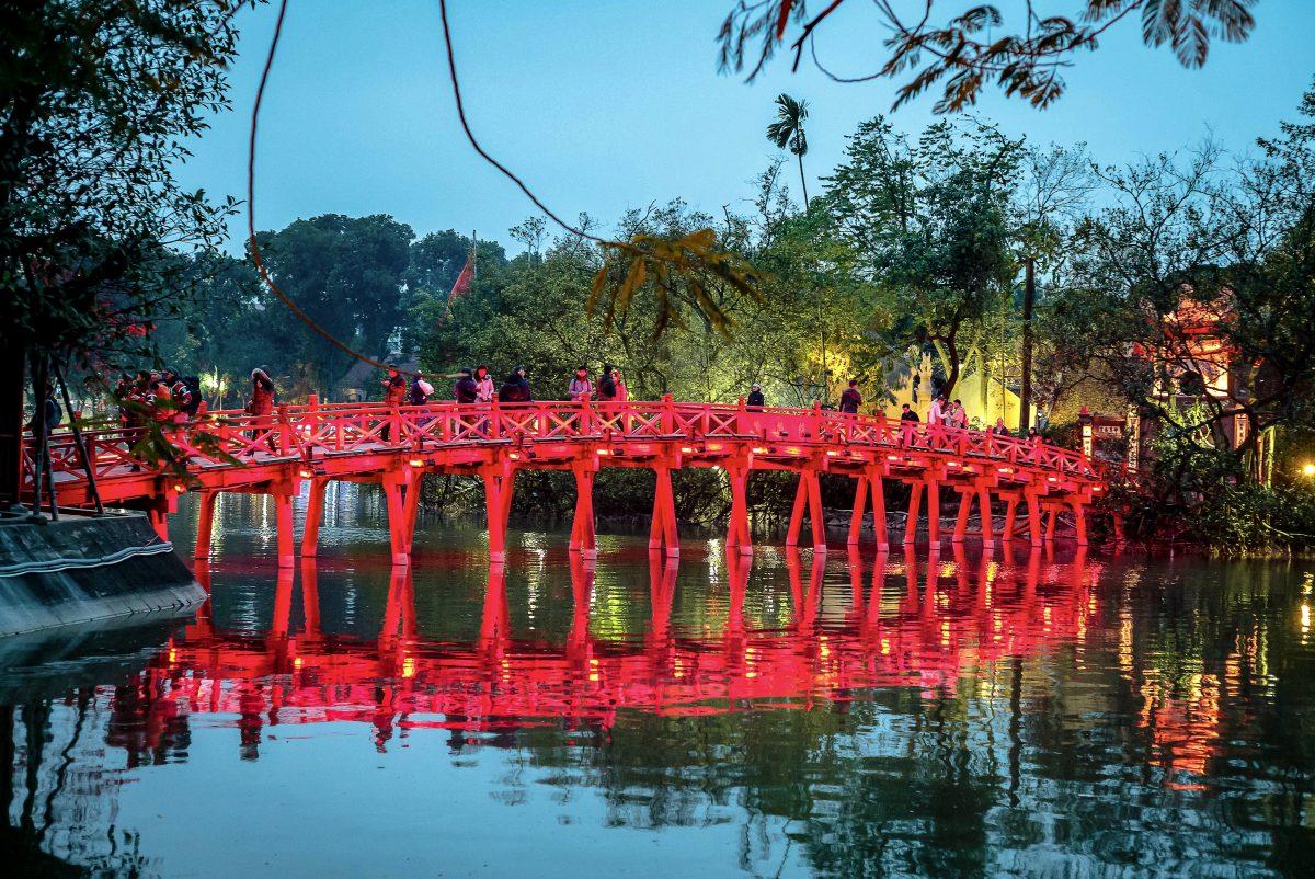 Bright red bridge in Hanoi Lake