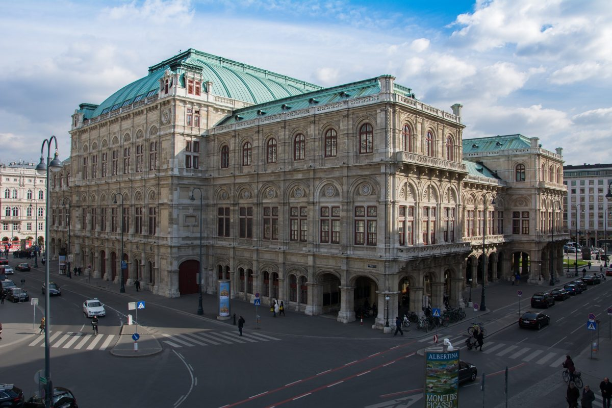 The facade of Vienna State Opera is beautifully decorated in Renaissance-style with a grandiose entrance featuring five iconic statues