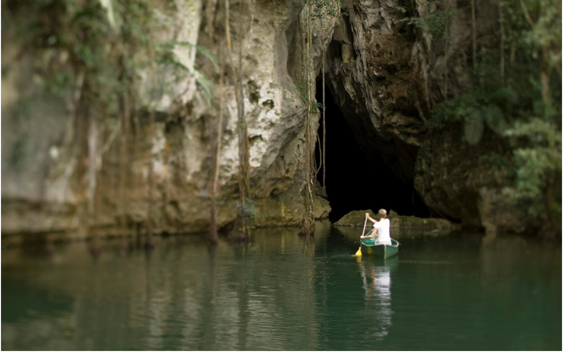 The Barton Creek Cave gives access to the breathtaking view that the Maya Mountains on Barton Creek offers
