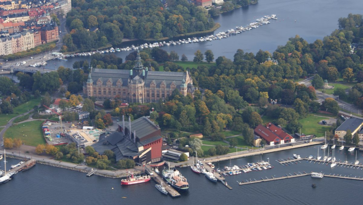 Djurgården, overhead shot with an amazing view of the the island, with forests surrounding buildings, the sea and boats