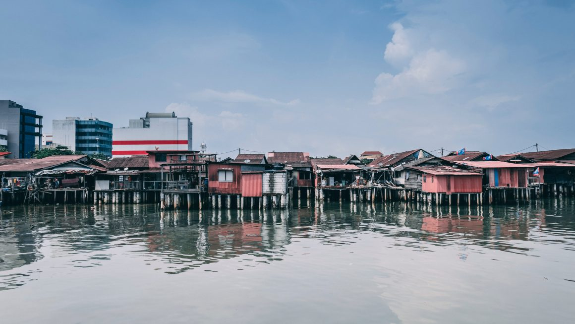 Beautiful first person view of Penang's kelong houses with the city in the background