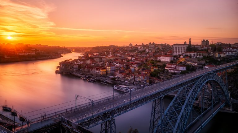 Awesome sunset shot of Porto's skyline with the icons Dom Luis Bridge, Duoro River and Cais da Ribeira featured