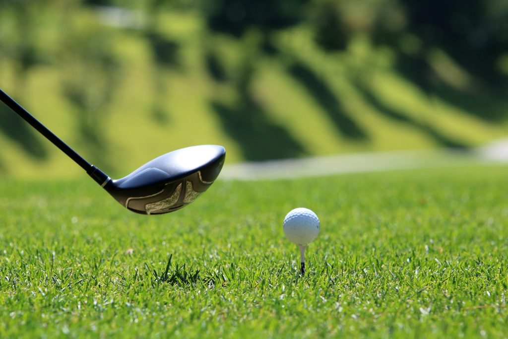 Golfing on green fairway