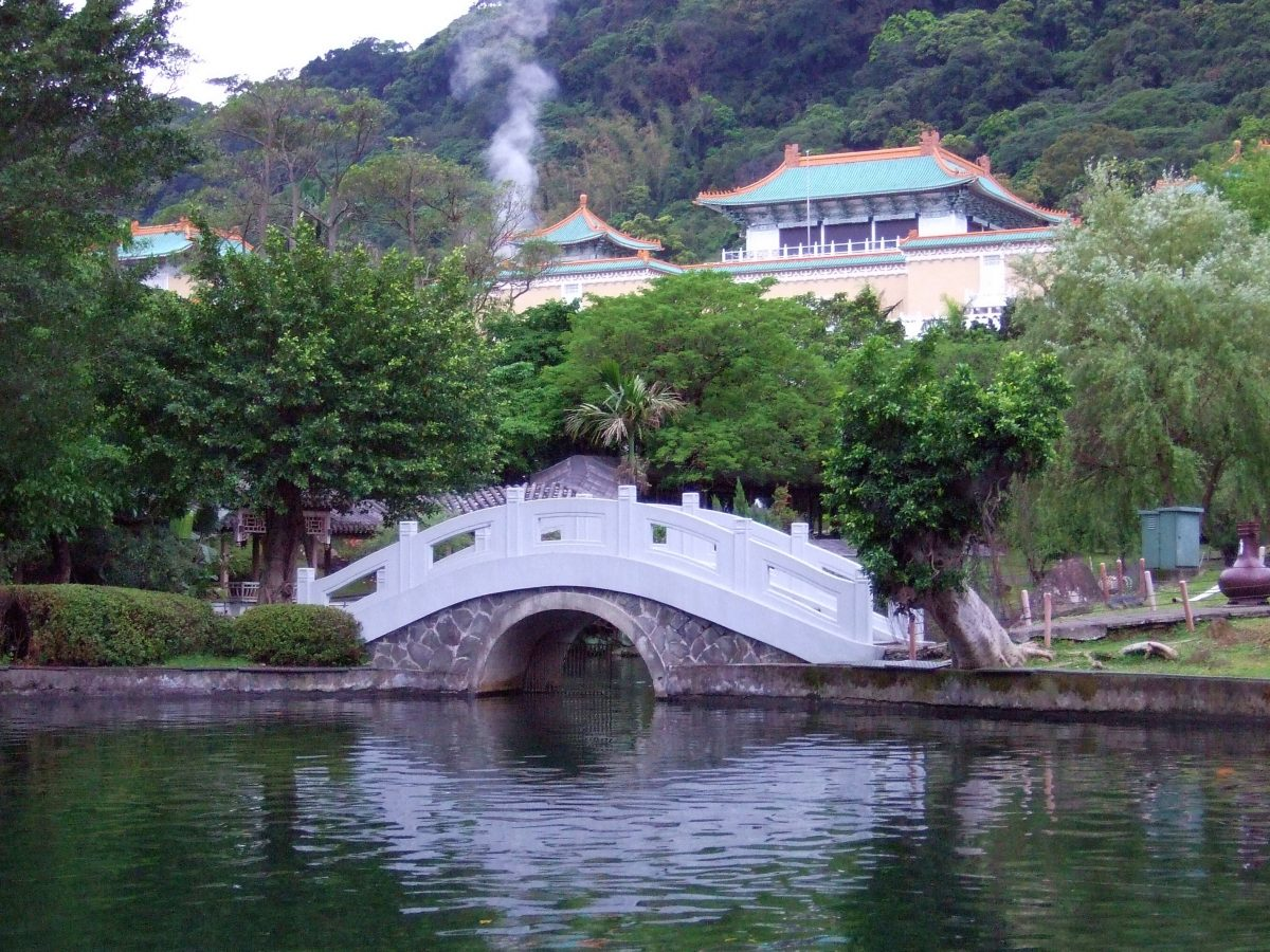 Ornamental pond and bridge just outside the National Palace Museum, housing ancient oriental treasures that depict Taiwan's culture