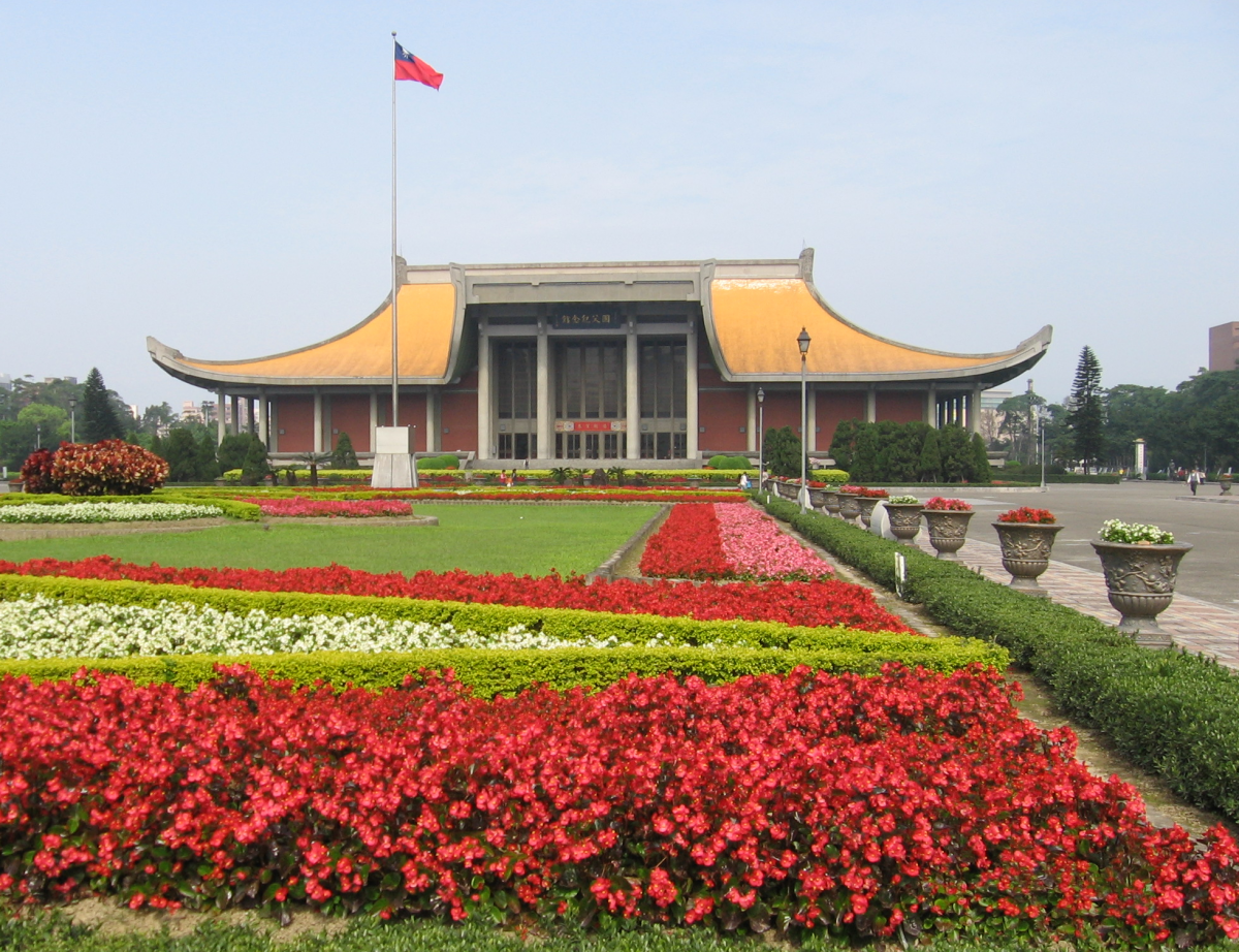 Courtyard of the Sun Yat-sen Memorial Hall with a beautiful garden filled with red flowers