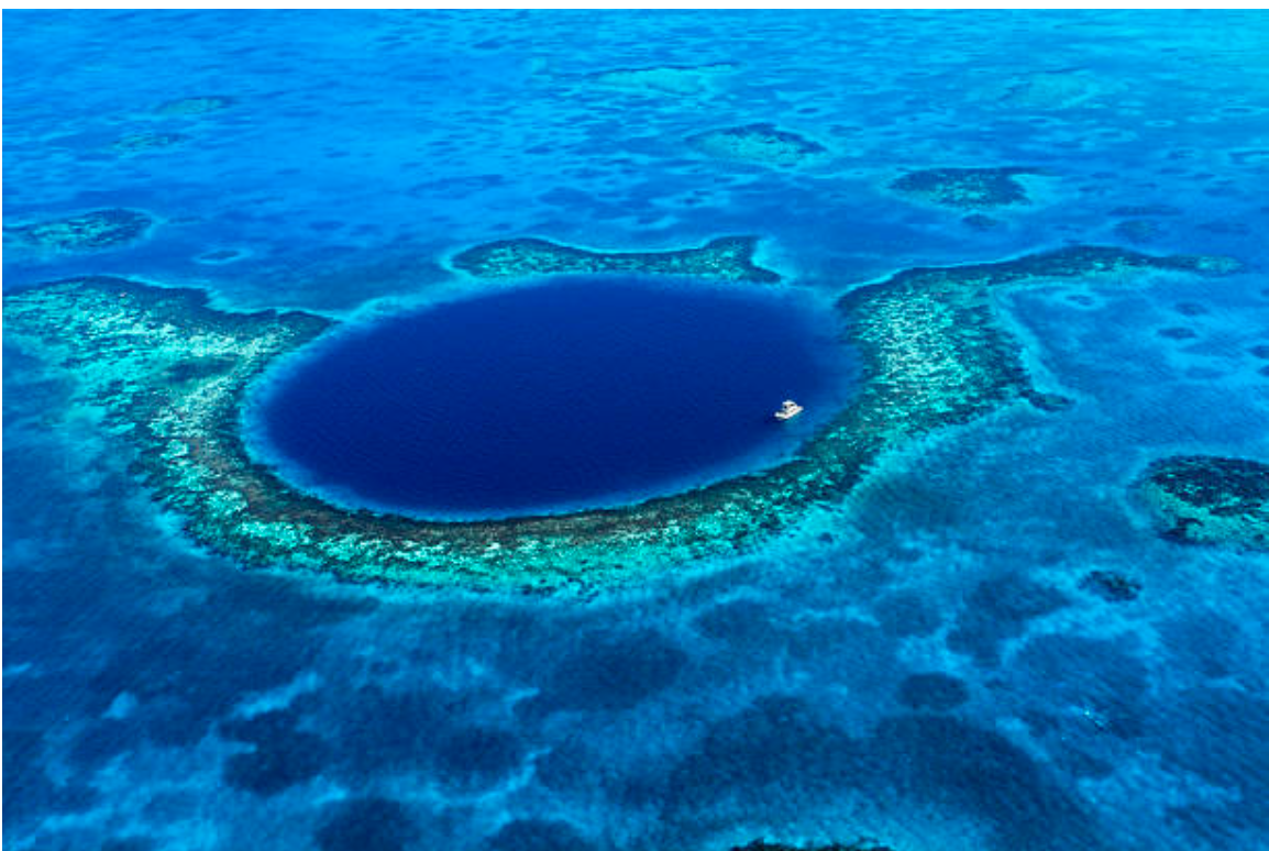 Divers from all over the world swim in The Great Blue Hole's crystalline waters to meet the diverse sea life below