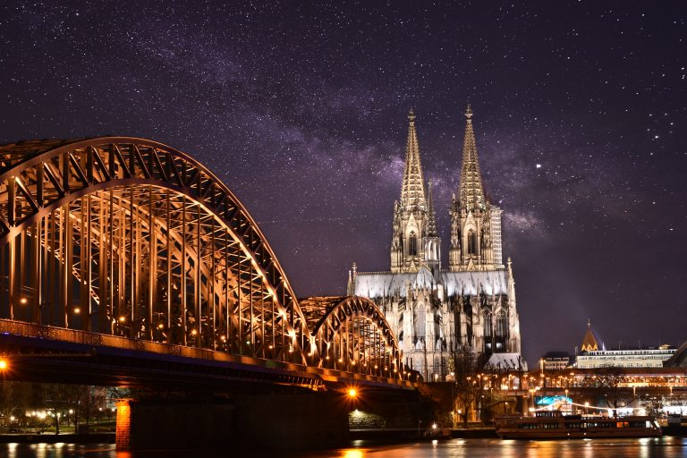 Night view of Cologne over city bridge