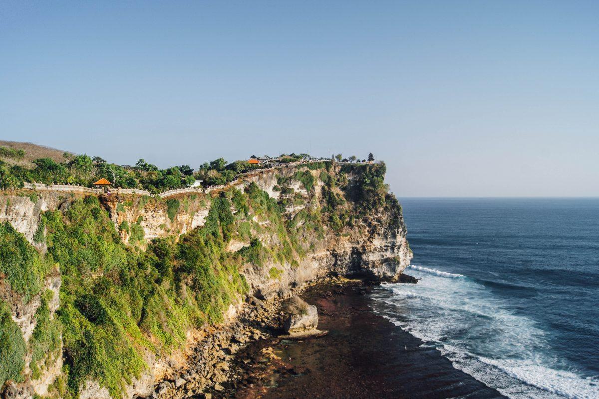 sea waves crashing on the cliff of Uluwatu Temple, Bali