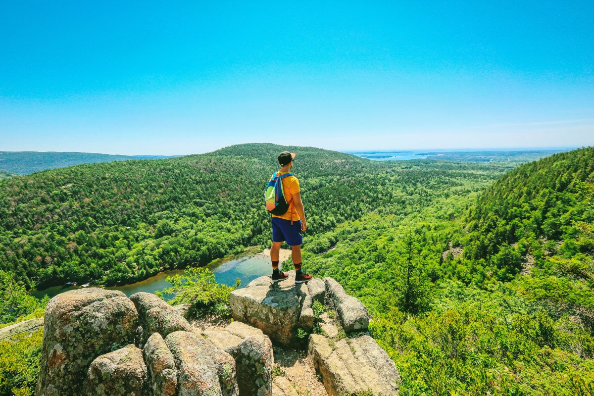 A man is hiking in the Acadia National Park