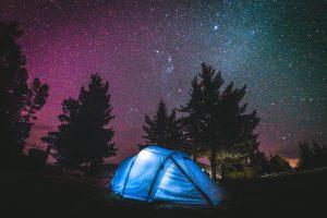 Family camping at night