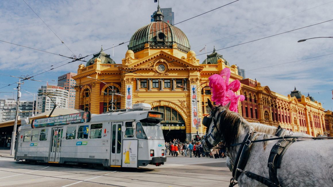 Panoramic view of Flinders street with tram passing by, Melbourne
