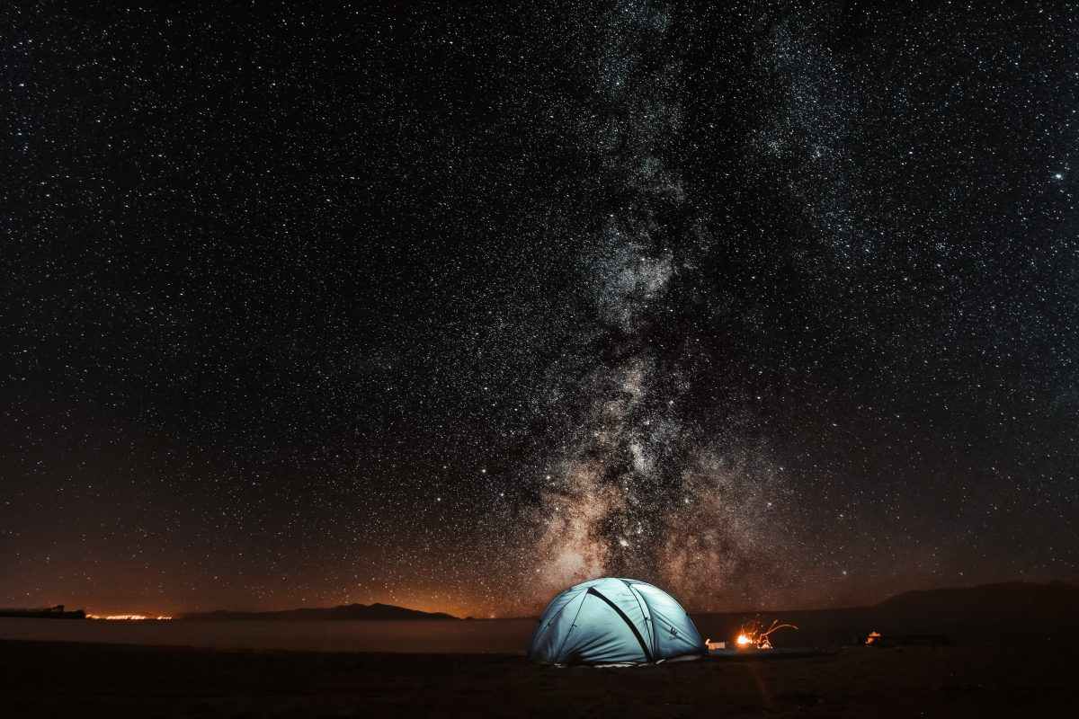 Blue tent under milky way