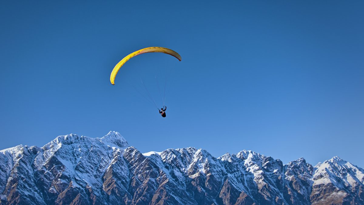 Figure paragliding over the mountains