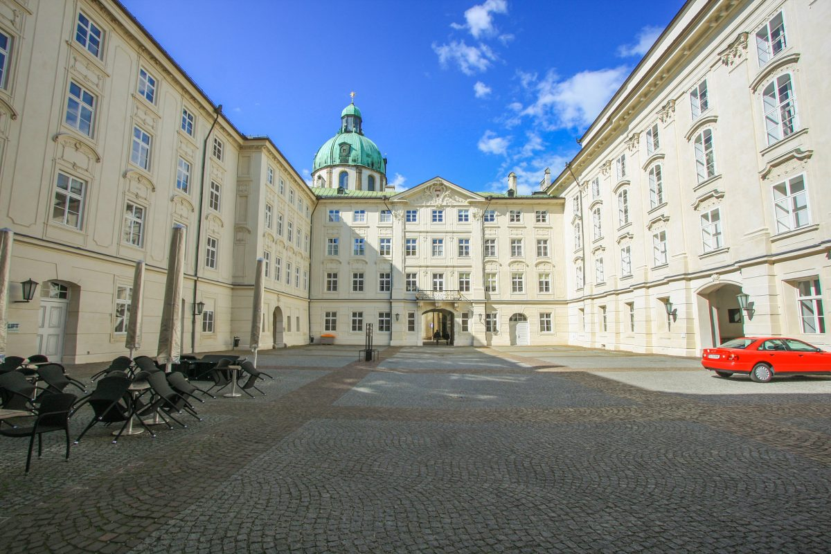 Hofburg white building with green dome