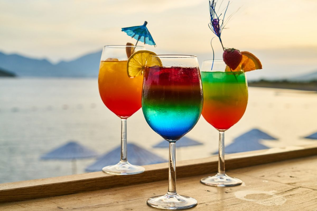 Colorful drinks on a table at a beach