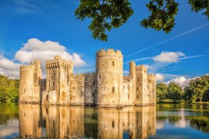Bodiam Castle still stands tall today like something out of a storybook with its imposing stone towers surrounded by a moat