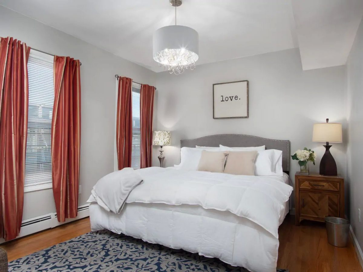 This stylish Airbnb Boston rental features a king bed, a sitting area and ample closet space
