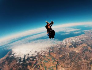 Two people skydive above the amazing landscapes of California
