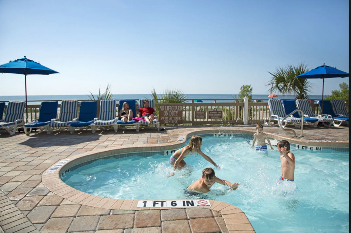 Boasting a large oceanfront pool and outdoor jacuzzis, there is no shortage of pool amenities at Coral Beach Resort