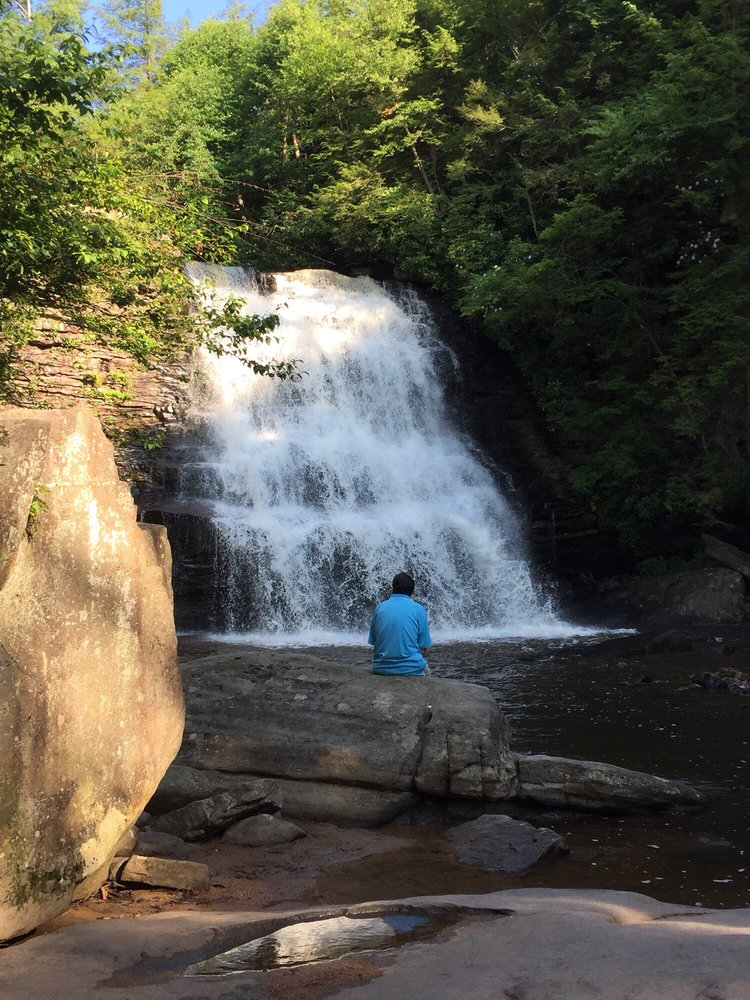 Man sitting at Waterfall in Swallow Falls State Park