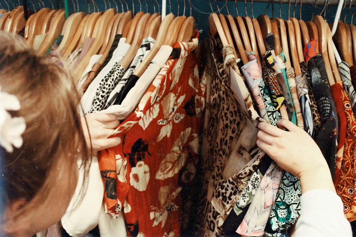 Woman browsing clothing at shop
