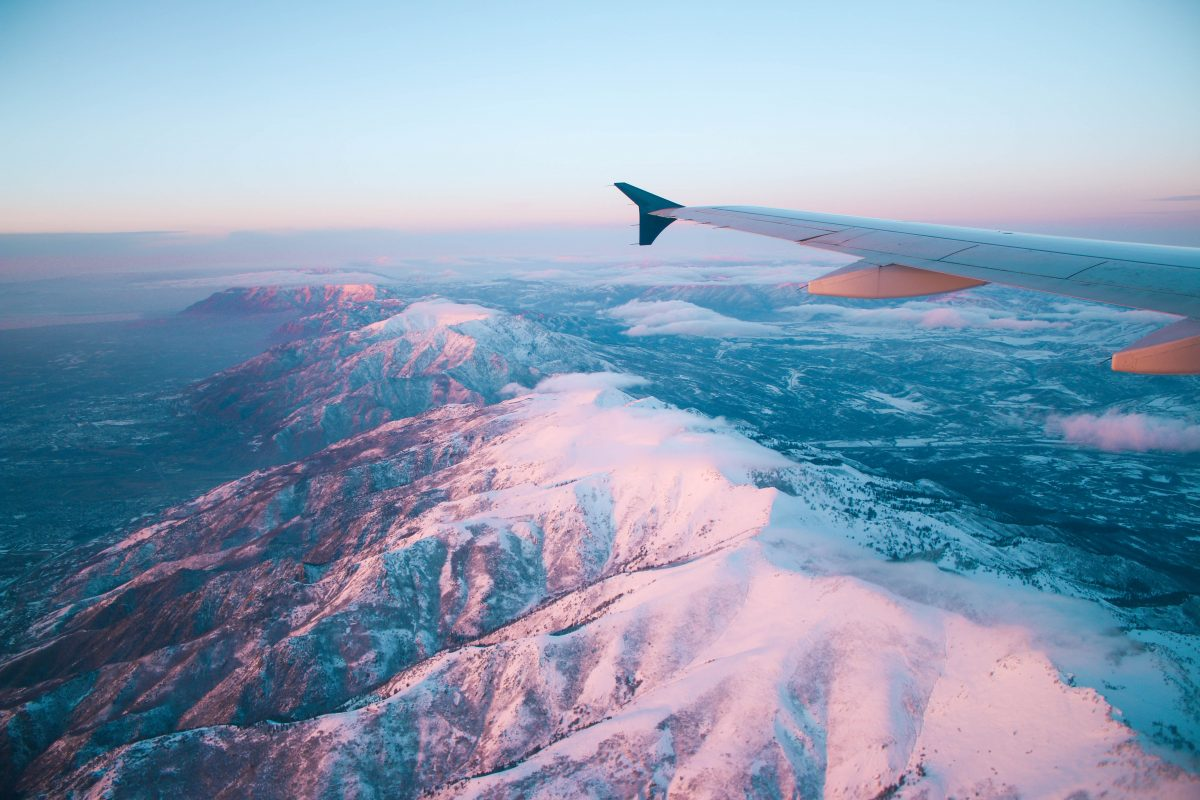 View of snow capped mountains from an airplane