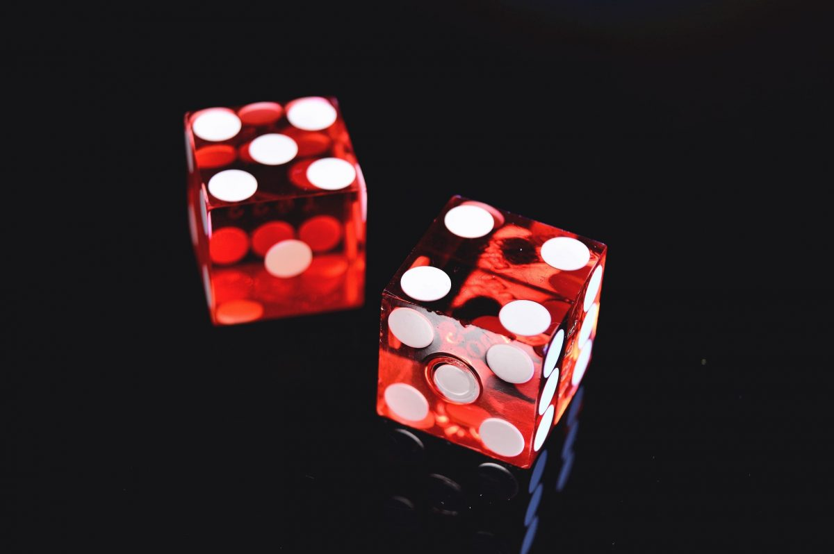 2 red dices on black background