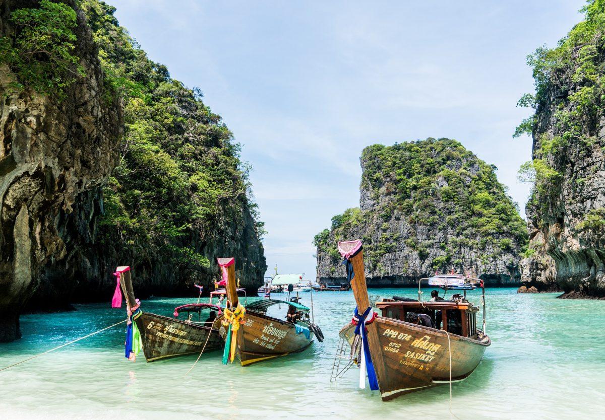 Three boats docked in Koh Phi Phi, Thailand