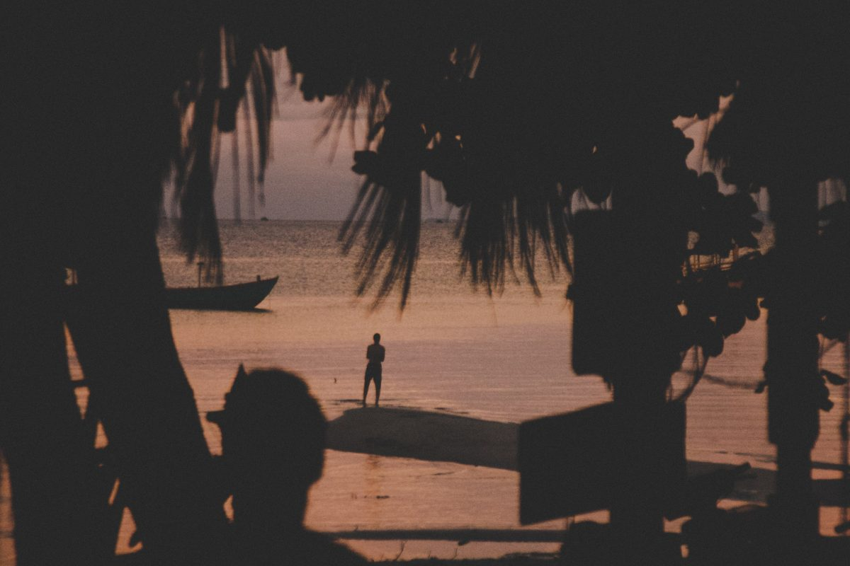 A man gazes at the sunset in Koh Rong Sanloem, Cambodia