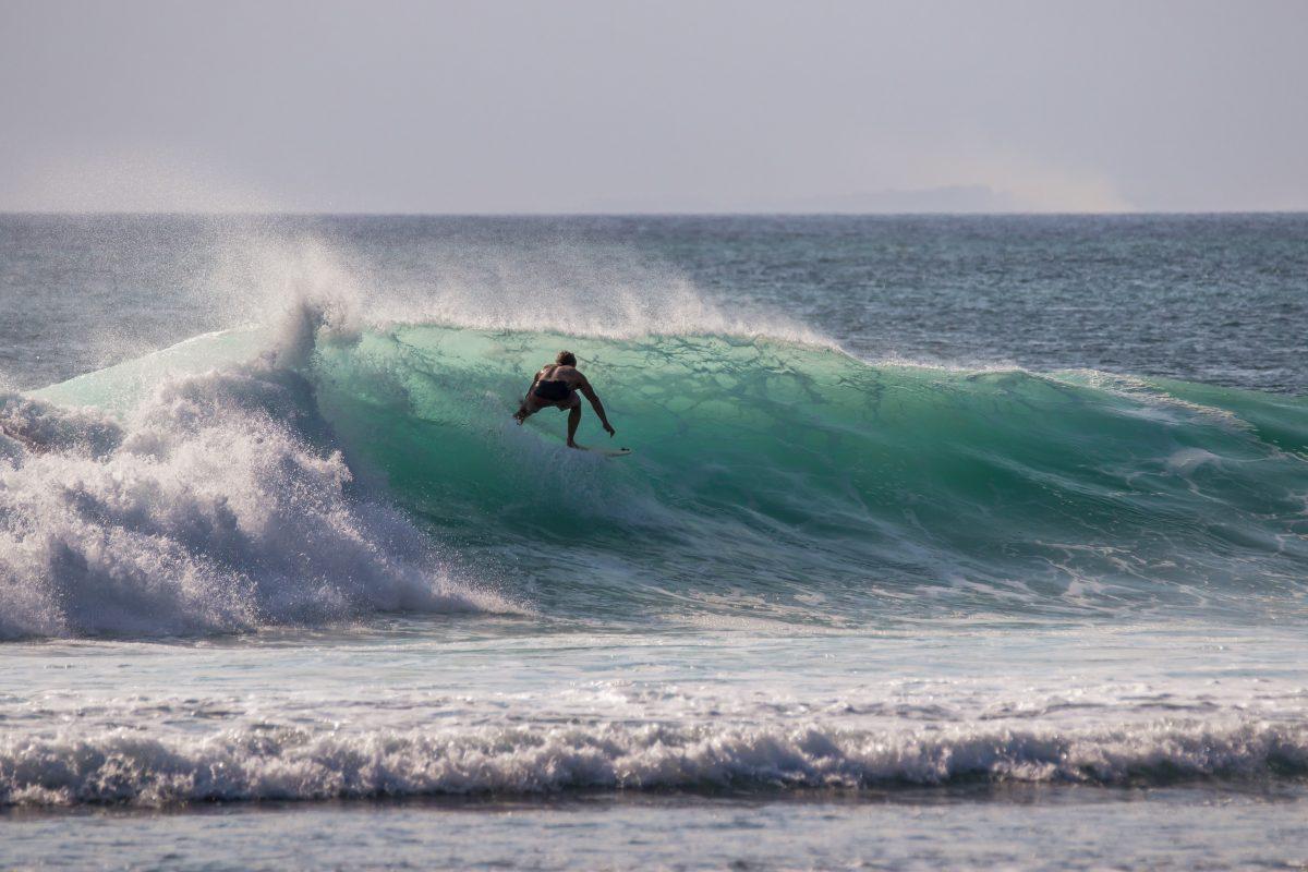 Surfing at padang padang beach Bali